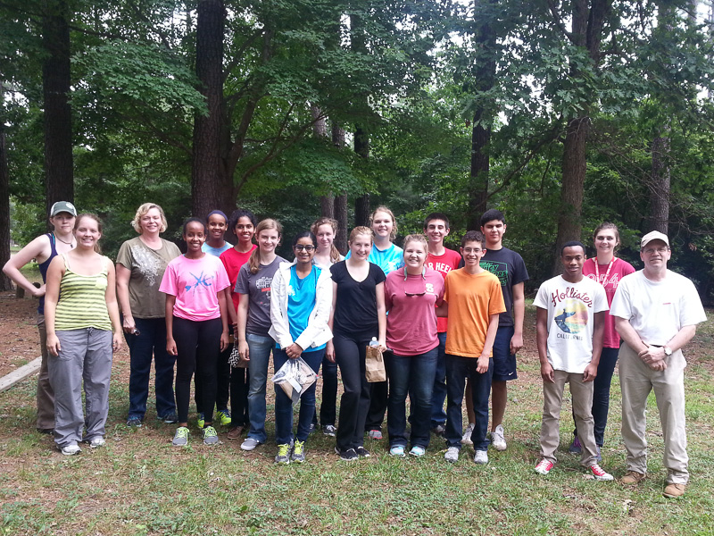 Photo of students in the SCIBLS (Summer College in Biotechnology and Life Science) PP150, Introduction to Molecular Biology course. This was a field trip to Schenck Memorial Forest led by Dr. Marc Cubeta.